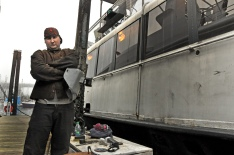 Gerard, 27, works fixing boats in the docks of Granville Island. Saturday, Feb. 2, 2013.