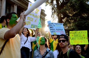 "Hundreds of Brazilians protest in front of the Vancouver Art Gallery in support of mass demonstrations by Brazilians all around the world, on June 24, 2013. With green and yellow painted faces, in reference to their native flag, they took the streets of Vancouver holding posters saying ""We don't need a World Cup, we need a better country"" and ""Stop police brutality."""