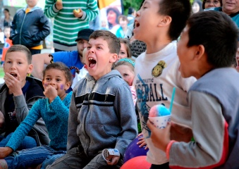 Kids take in a performance at the storytelling tent at Surrey Children's Festival, at Bear Creek Park. Saturday, May 25, 2013.