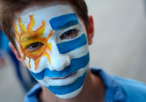 An Uruguayan boy painted with colours of his national flag waits for a FIFA World Cup soccer match between Uruguay and Costa Rica at Arena Castelao in Fortaleza, Brazil, Saturday, June 14, 2014.